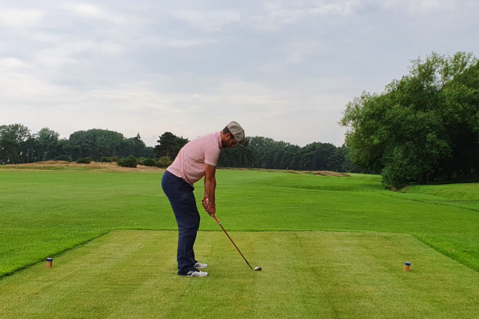 player teeing off flempton golf club